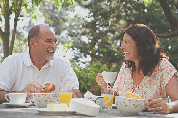 man and woman drinking tea and laughing